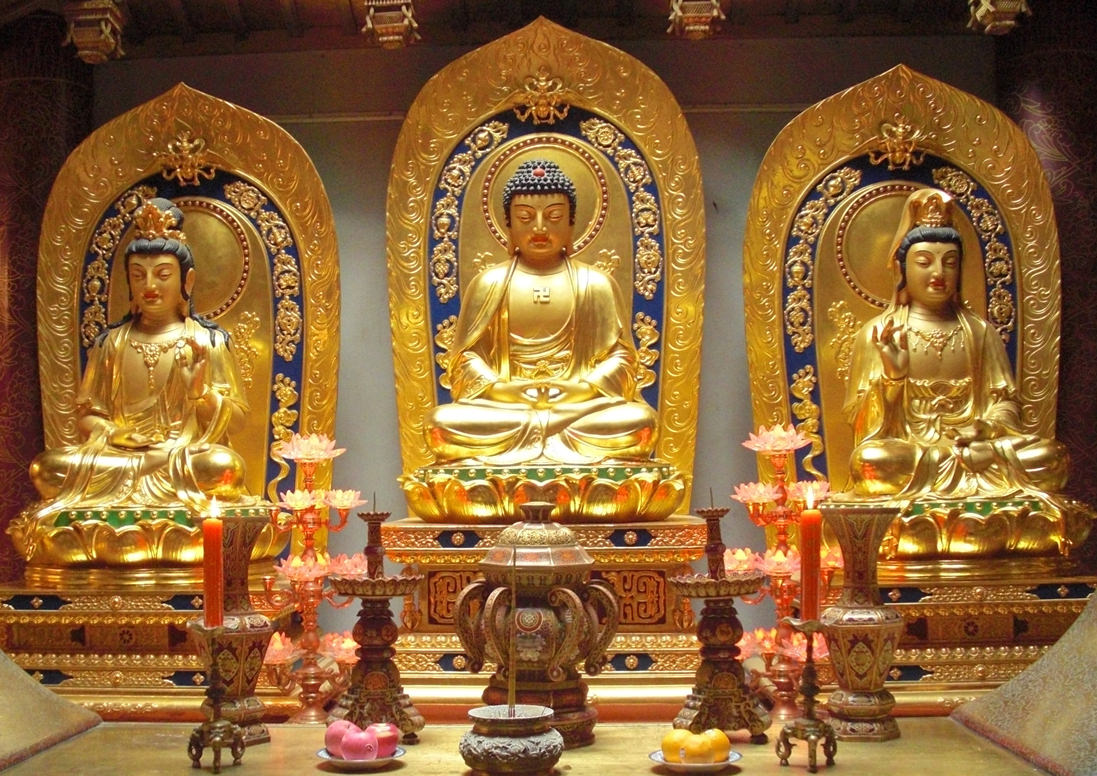 Amitabha in the center with his two assistants